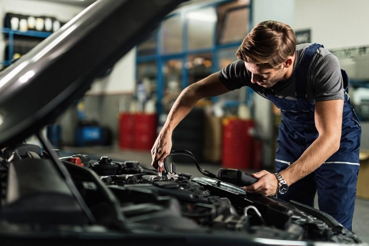 A qualified technician conducting a car service.